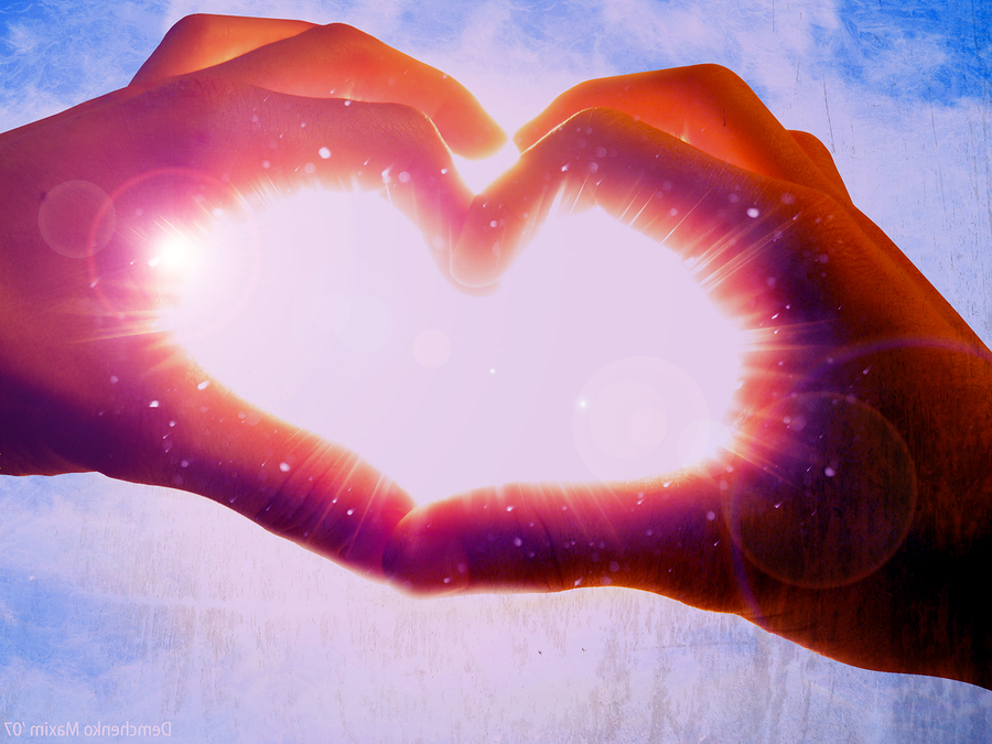 bigstockphoto_hands_of_love_the_sun_is_o
